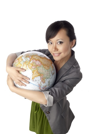 Close-up image of a woman embracing the globe isolated on a white surface Stock Photo - 17084685