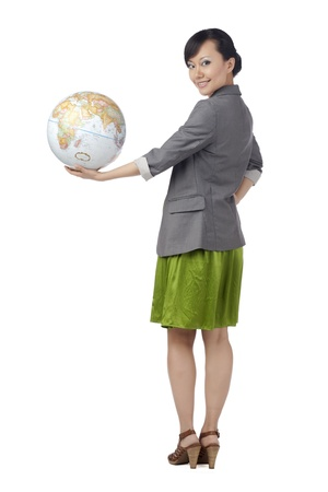 Back view image of a woman holding the globe in hand against the white surface Stock Photo - 17071073