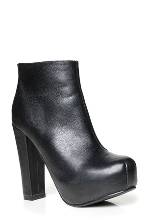 heeled: Black leather high heeled boot isolated in a white background