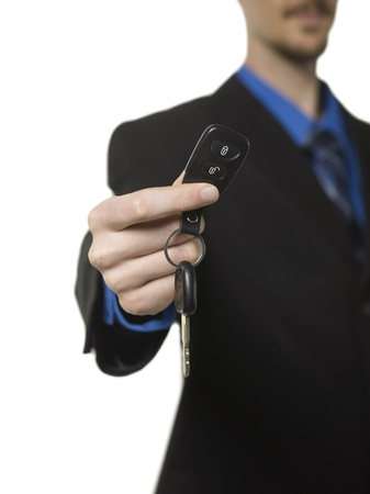 Image of businesswoman holding a key against white background photo