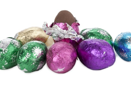 foil: Foil wrapped chocolate eggs against white background Stock Photo