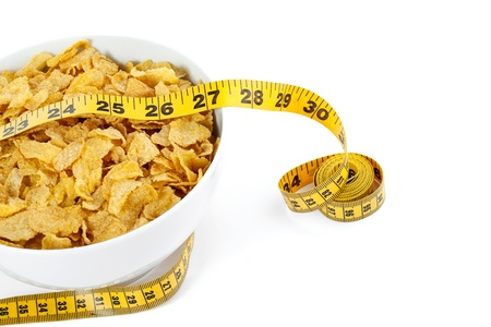 Close up and macro image of corn flakes bowl with yellow measuring tape isolated on Stock Photo - 16999257