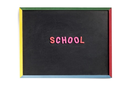 learing: Close-up image of a empty slate board with school written on it with plastic alphabets. Stock Photo