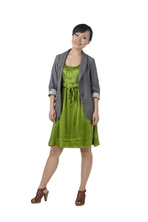 Portrait of fashionable asian lady wearing green dress against white background Stock Photo - 17071067