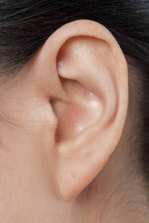 Close-up image of a females left ear
