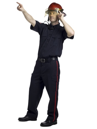 fire fighter: Full length portrait of fire fighter pointing something against white background