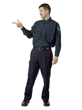 Full length image of a law officer pointing his fingers like a gun Stock Photo - 17084180