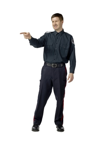Full length image of a pointing policeman over a white background Stock Photo - 17071066
