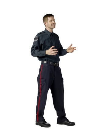 Full length portrait of policeman explaining something against white background