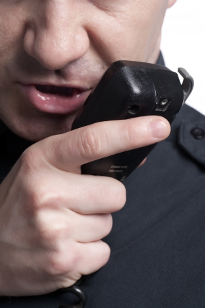 cb phone: Close up image of policeman talking cb phone
