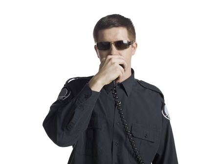 cb phone: Close-up image of a policeman talking on the radio against the white background Stock Photo