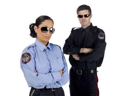 Portrait of police officers wearing sunglasses against white background