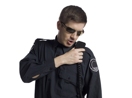 deputy: Close-up image of a police officer seriously talking on the radio against white background