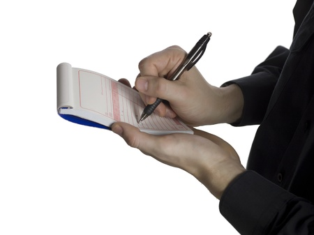 Cropped image of a police officer writing on his notes on a white surface Stock Photo - 16997729