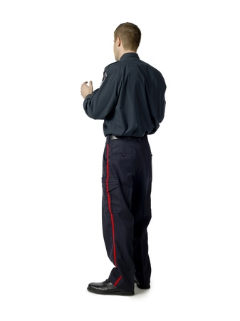 rear view image of a standing policeman over a white background Stock Photo - 17084130