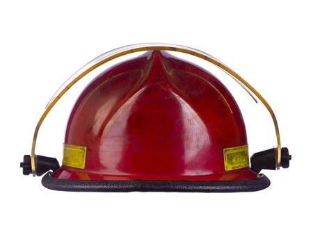 Close-up beeld van rode brandweerman helm tegen een witte achtergrond Stockfoto