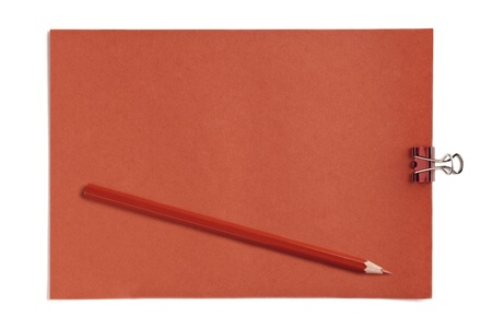 Close-up image of red paper with clip and colored pencil photo