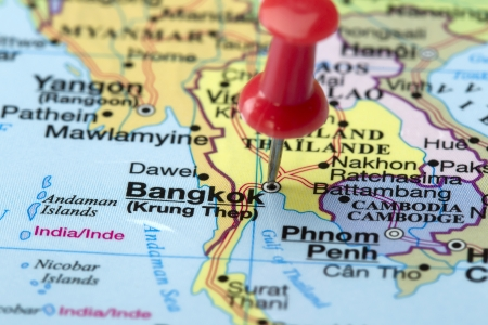Cropped image of a world map with a red pin focusing the Bangkok Stock Photo