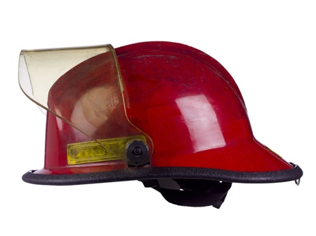 Red protective helmet for firemen isolated in a white background photo
