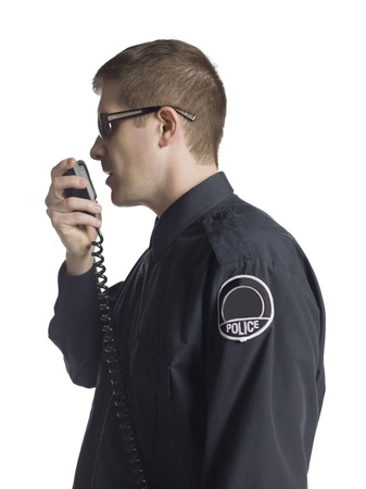 Policeman having radio conversation photo