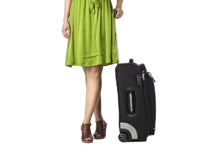 unrecognized: Unrecognized woman holding her luggage bag isolated on a white background Stock Photo
