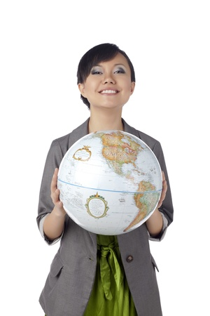 Asian woman holding a globe photo