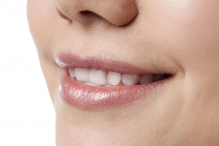 Close up of woman with toothy smile
