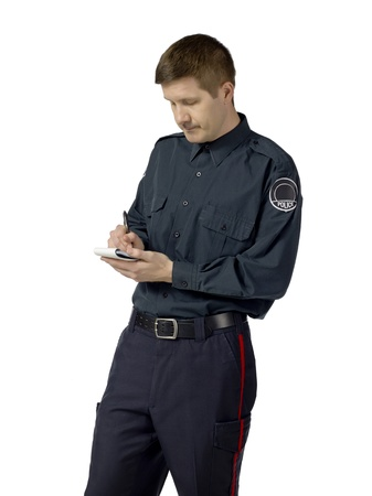 Close-up image of a handsome policeman writing on his notes Stock Photo - 17084453
