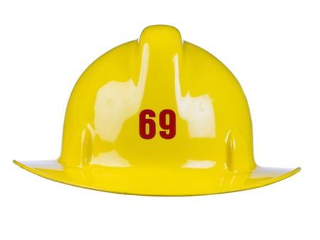 Close-up image of a shiny yellow firemans helmet against the white background