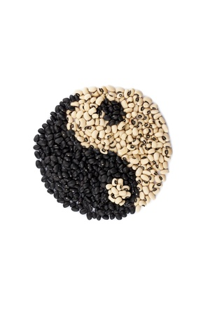 yang ying: Symbol of a ying yang made up of black and white beans isolated on a white background