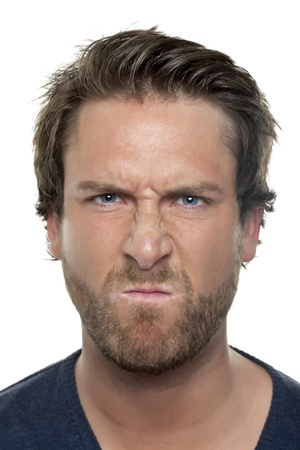 Close-up image of angry face of man isolated on a white background Stock Photo - 17106684