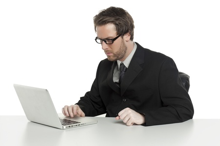 Close-up image of busy businessman using a laptop while sitting on the office Stock Photo - 17109200