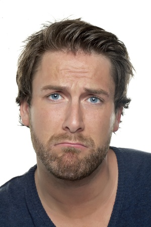 sad face: Close-up image of a man making sad face against the white background