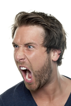 Close-up image of a mans face shouting while looking on the side of a white background photo