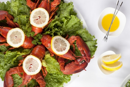 Overhead shot to the plate with green salad and whole lobsters with lemon slice Stock Photo - 17085317