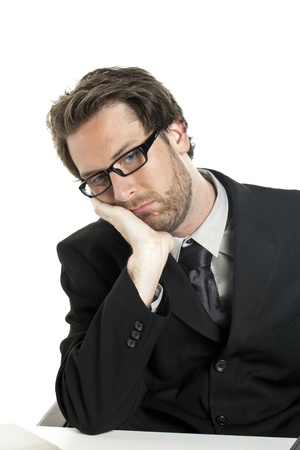 Portrait of a tired businessman resting on a white background photo