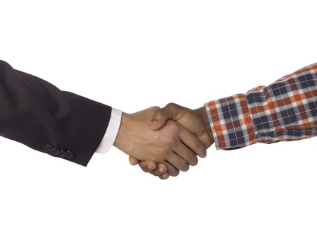 Close up of businessman partners doing shake hands against white background Stock Photo - 17085189