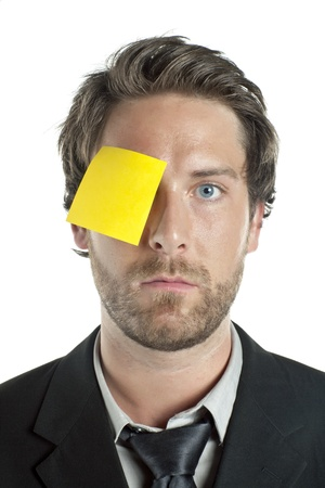 Close-up portrait of a businessman with a yellow note on the right eye Stock Photo - 17085280