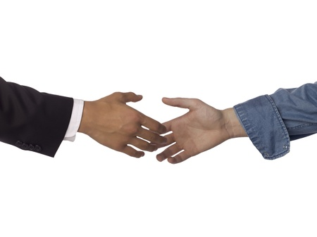 Close-up image of businessmen about to handshake over the white background Stock Photo - 17085092
