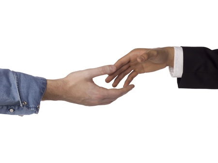 Close-up image of the businessmen handshake over the white background Stock Photo - 17085086