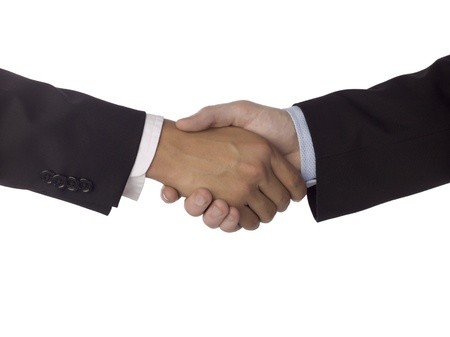 diplomacy: Closed up hands of two business people doing a hand shake to show agreement Stock Photo