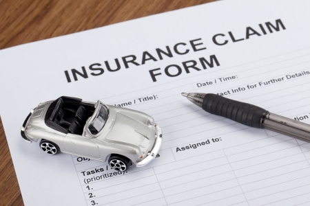 collectibles: Close up image of collectible toy car with insurance form