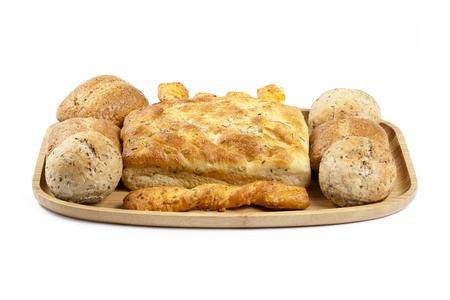 Image of delicious bread set in wooden tray against white background photo