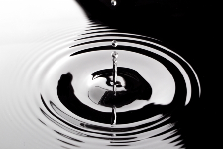 Close up image of falling water drop on black water Stock Photo - 17085384