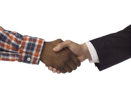 Male and female hands doing a handshake over a white background 免版税图像