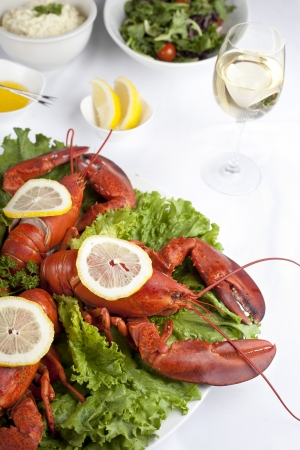 Close-up image of a lobster dish with white wine on the side of a wooden table Stock Photo - 17085296