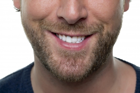 Close-up image of lower half of man's face focusing the mouth and nose against the white background Stock Photo - 17085295