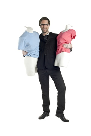 designer: Male fashion designer holding two manikins over a white background