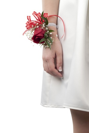 Close-up image of human wrist with prom corsage isolated on a white background