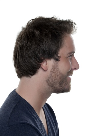 Side view image of a man's face smiling over the white background Stock Photo - 17085364